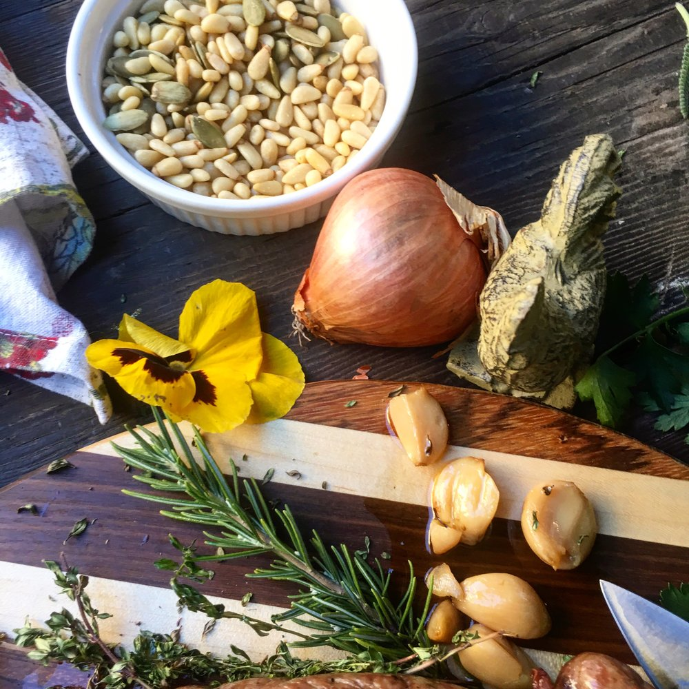 Pine nuts can go on everything, from savory to sweet. Oh, look, garlic (I-use-it-all-the-time) confit. I think a jar of garlic confit should be acceptable as price of admission to the most exclusive parties and concerts. Who's with me.