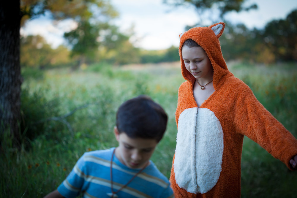Felix the fox (Delaney Wingrove) follows Thomas (Bryce Gheisar) through the Who Knows forest : photo by Lisseth Lopez.jpg