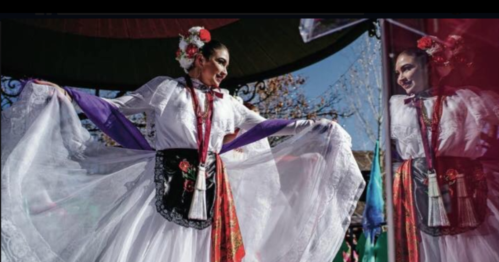 Barbara Garcia rehearses in a window front for the 2019 Women's March in Santa Fe. Source:  The Santa Fe New Mexican.