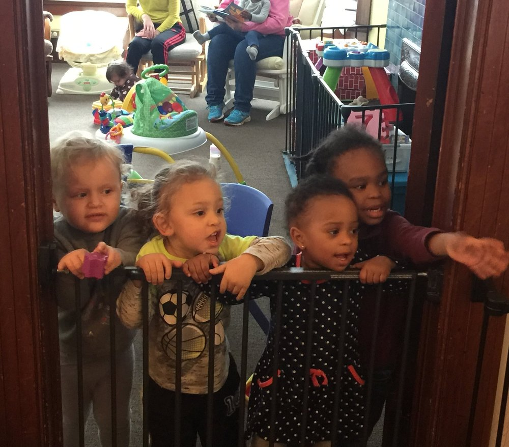 Some of our children greeting visitors at our daycare entrance.
