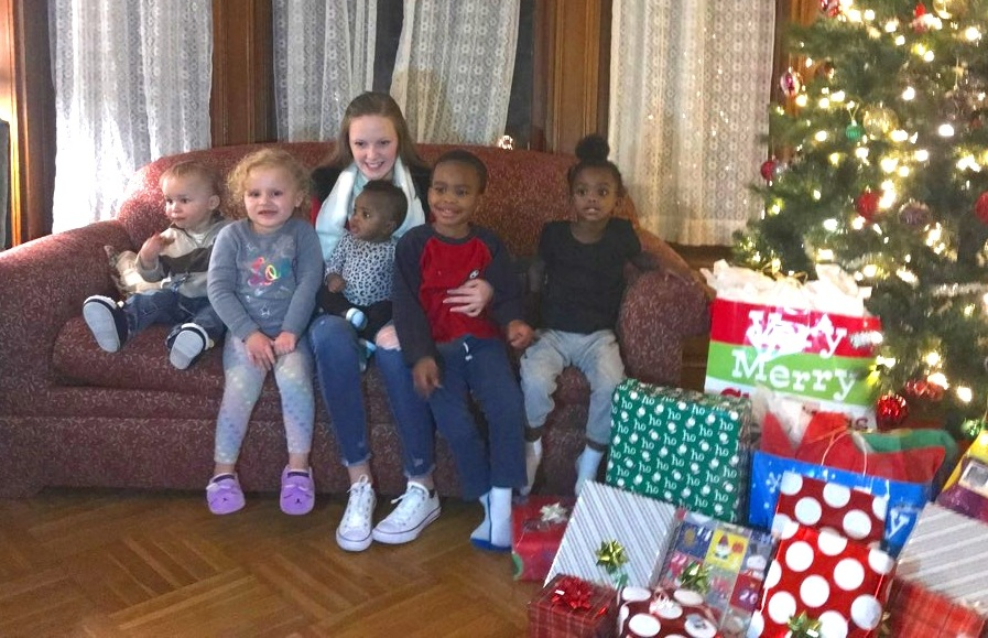 Erin Byrnes, with some of our little ones, is a never-ending gift to Joseph's House!