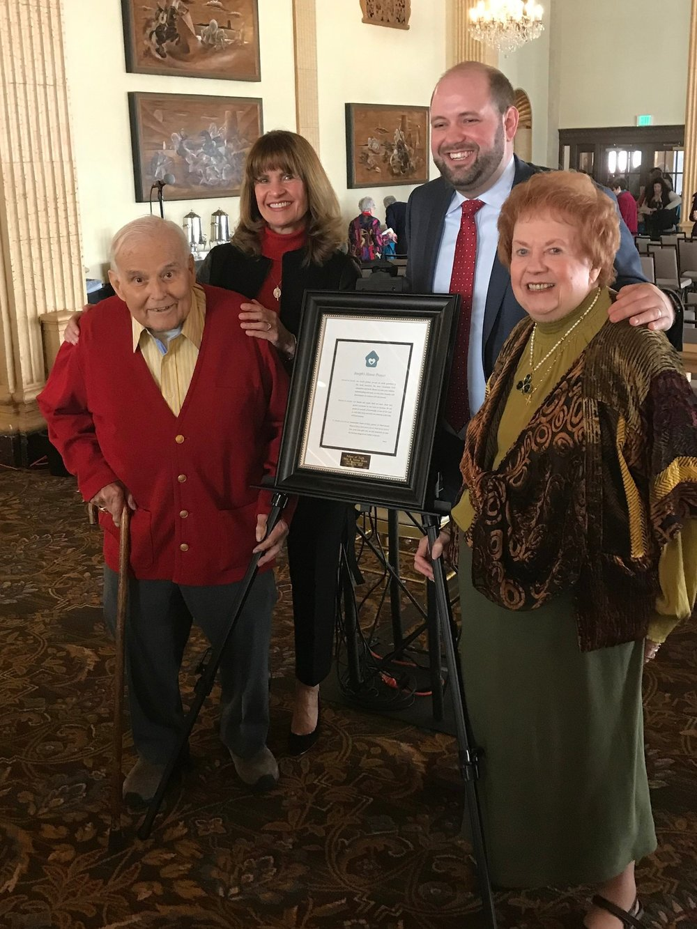 John & Teresa Brusa, receiving the Pillars of Faith Award with Kitty Spinelli and Bronson Kopp of Joseph's House