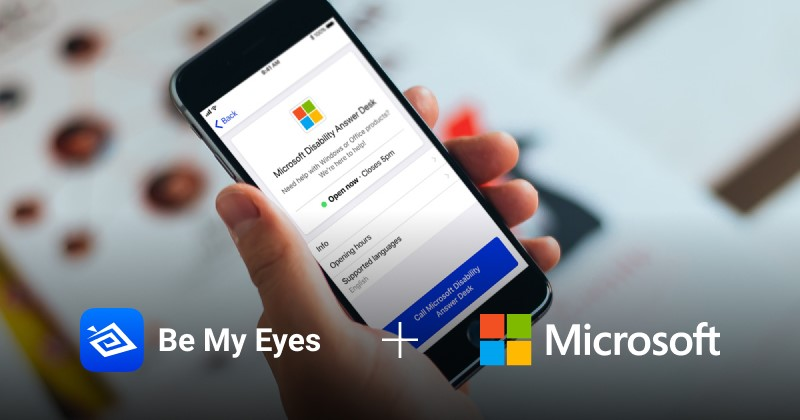 "Person holding cellphone with Be My Eyes, a smartphone app for Blind or Low Vision people, connected to Microsoft's Disability Answer Desk via a new feature called Specialized Help. (overlaid white text at bottom of photo reads, ""{app logo} Be My Eyes + {company logo} Microsoft""). Photo retrieved from:  https://blogs.msdn.microsoft.com/accessibility/2018/02/21/microsoft-joins-be-my-eyes-app/"