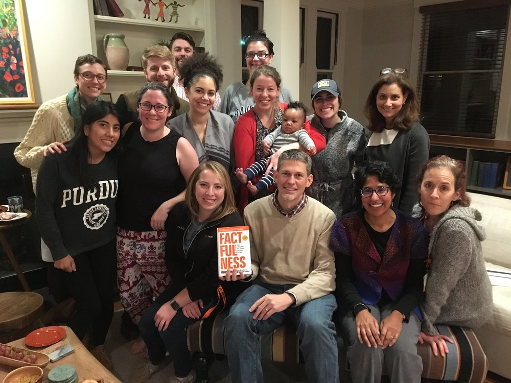 The global health book club group— enjoying snacks, conversations and a baby!