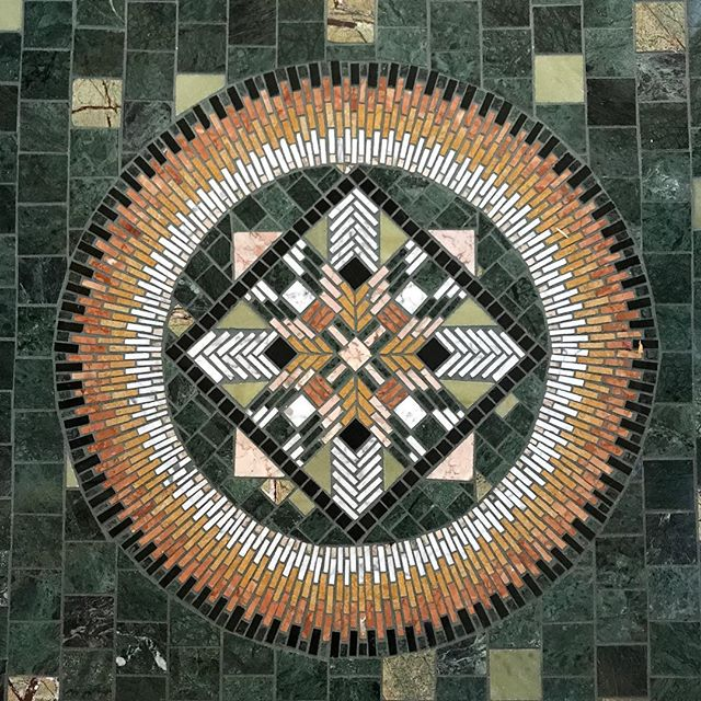 We went to a neighbors home tonight and she handmade this tile mosaic on her front porch. This is just one piece out of many at her home. Took her two years to complete her porch (she works full time so this is really a hobby...but one she's obviously really good at)!