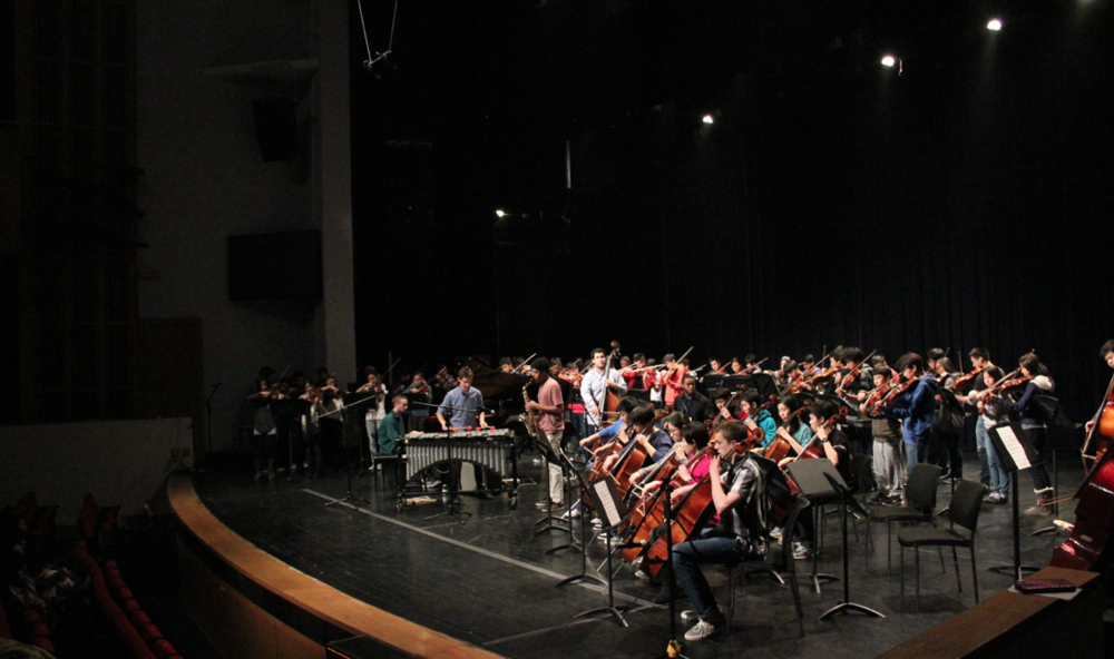 Chase Leading The International School Of Beijing Orchestra in a Jazz Performance.png