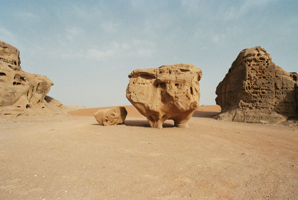 A unique sandstone rock formation in the desert of Wadi Rum, also known as The Valley of the Moon.