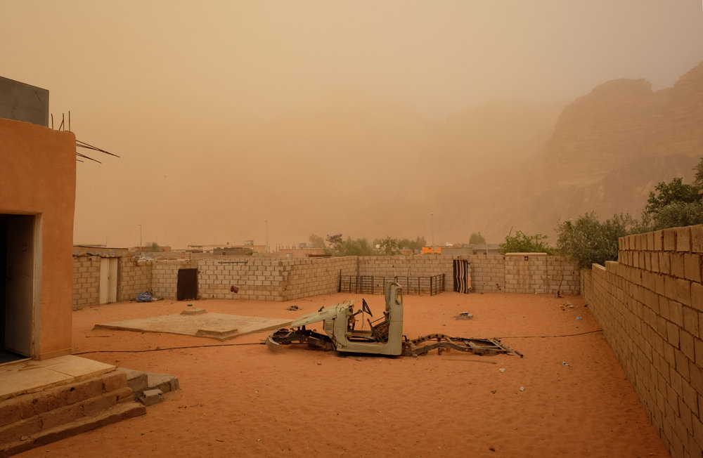Rum Village under the shroud of red sand blowing in from the desert.
