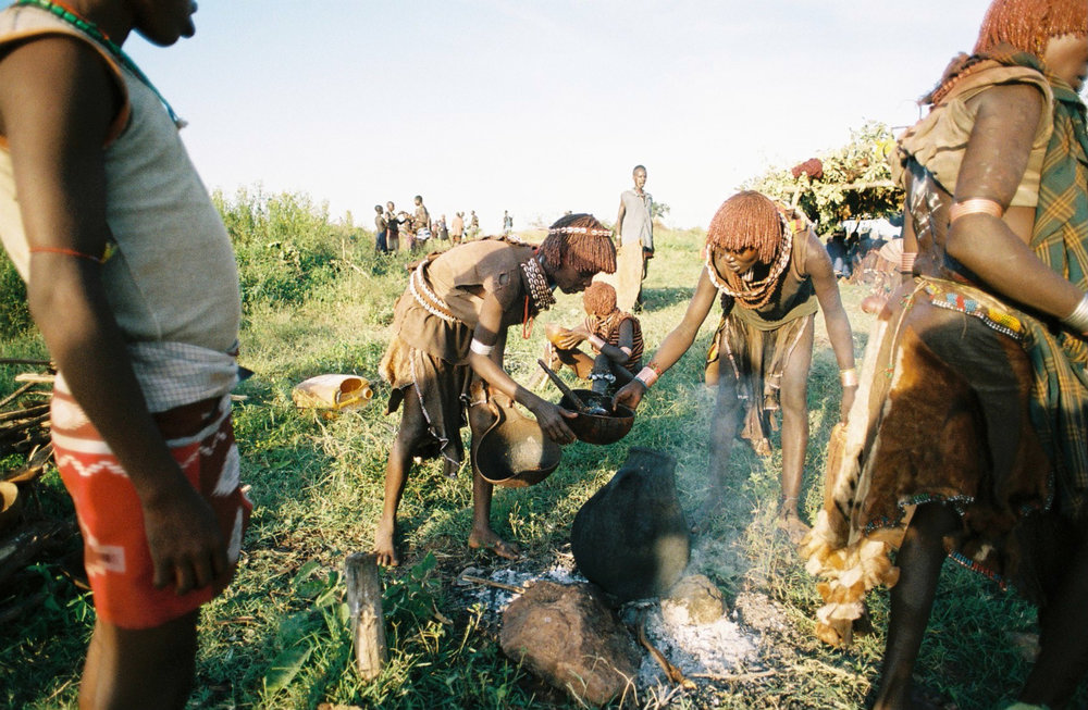 Hamar women preparing for a bull jumping ceremony  Photo By: Sarah Tesla
