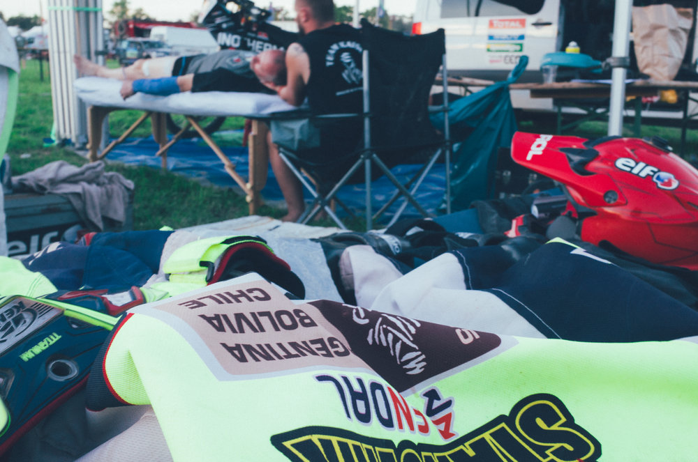 A rider getting a massage after a long day racing.   Photo By: Richard Rae