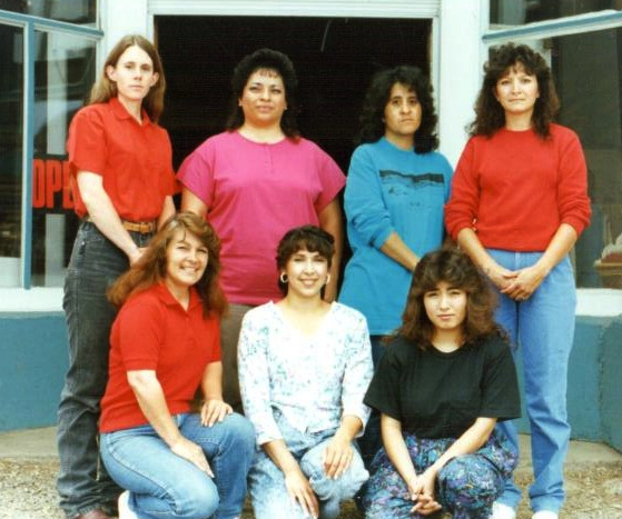 Some of the original members owners of Tierra Wools: Back row, l-r: Molly Manzanares, Norma Martinez, Angie Serrano, Johanna Terrazas. Front row, l-r: Karen Casias, Nena Russom, Carla Terrazas