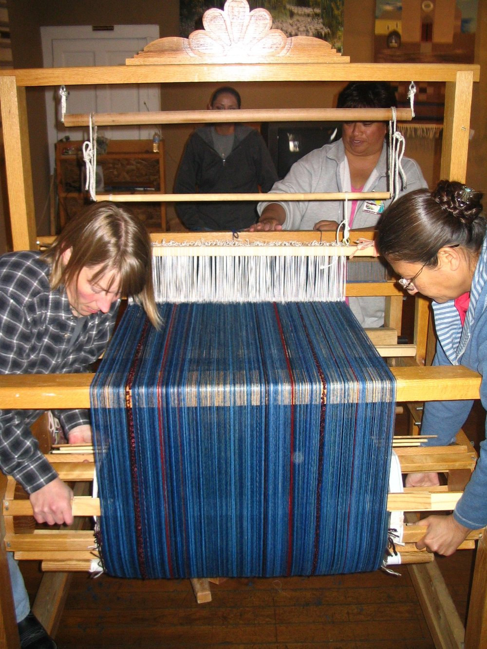 Winding the new warp onto the loom