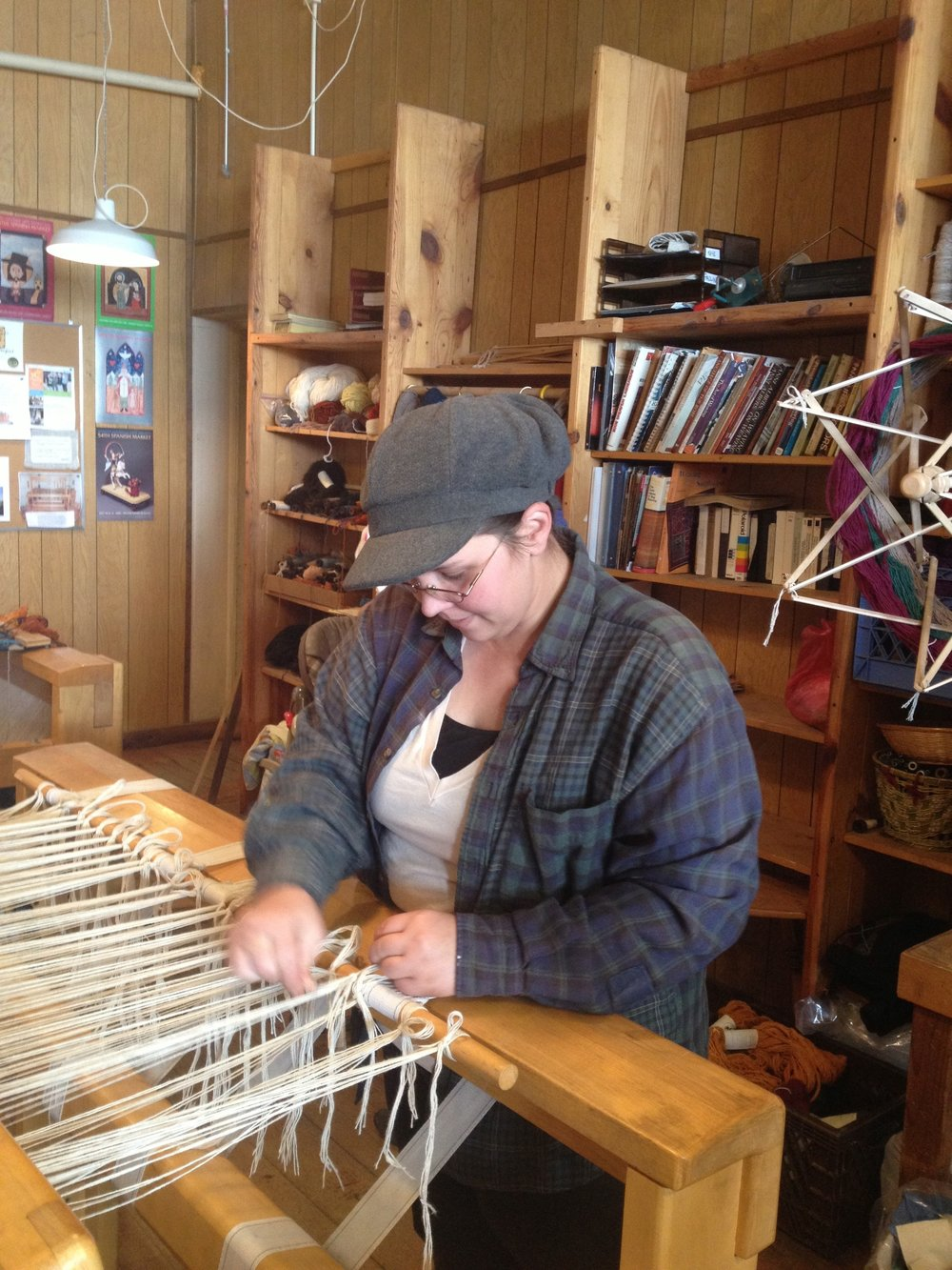 Tying the warp onto the front of the loom