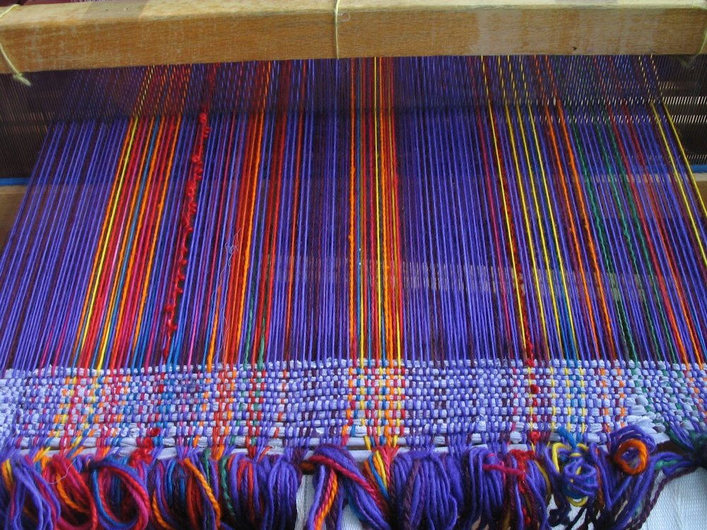Filler rags woven into the warp to prepare the loom for weaving with yarn threads
