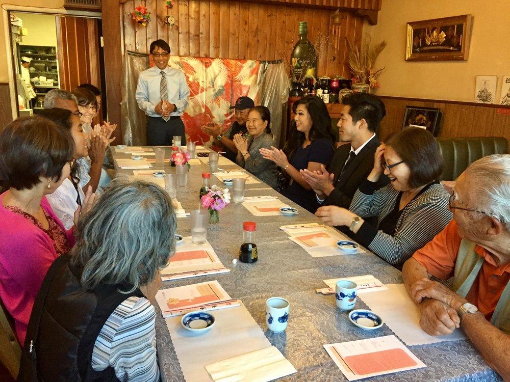 Masumi Asahi addresses the attendees