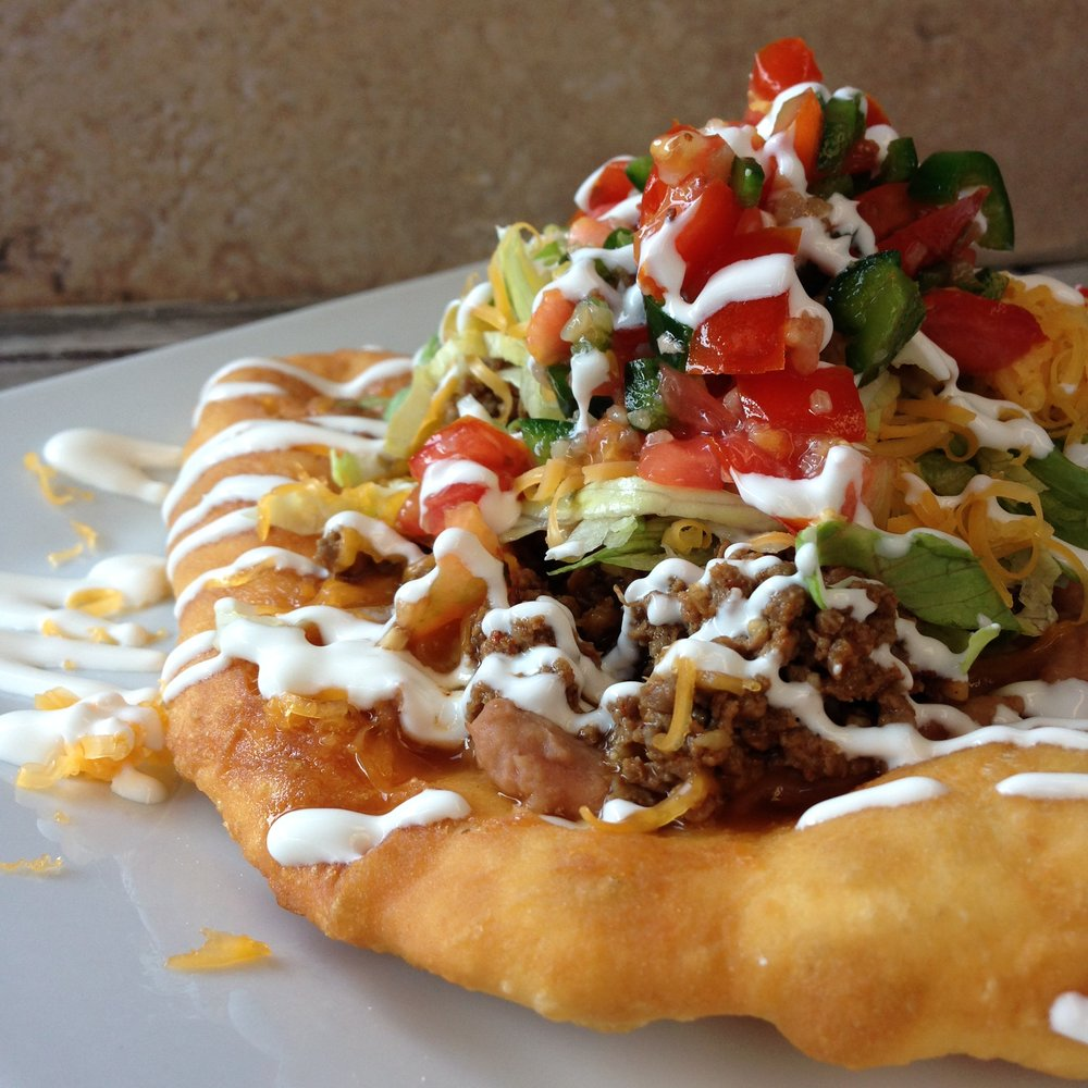 Navajo Indian Tacos - Our family grew up out West where traditional Native American food was served and featured on a weekly basis. After moving to Virginia, it was our desire to share this unique food with the you. It's a piece of homemade frybread topped with your choice of the following:- Beef Chili or Chili Beans (vegetarian option)- Lettuce, onions, black olives, diced tomatoes, cheese,   jalapenos, sour cream, & red sauce salsa