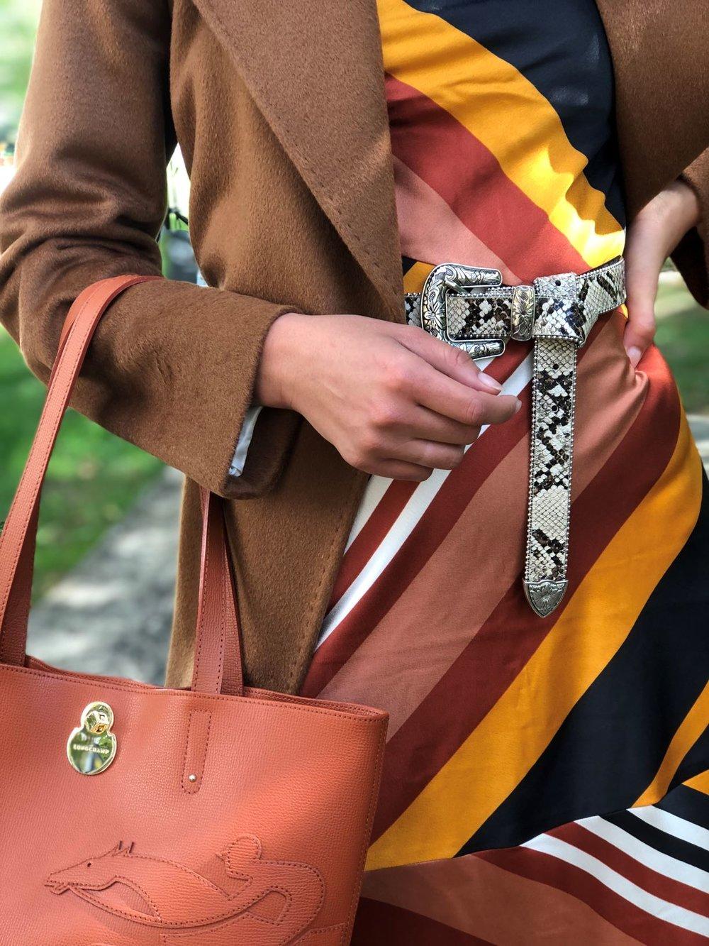 IMAGE: Styled and captured by NHJ Style team     Belted coat,      Jaeger     ; Striped dress,      Warehouse     ; Snake print belt,      Mango     ; Tote bag,      Longchamp