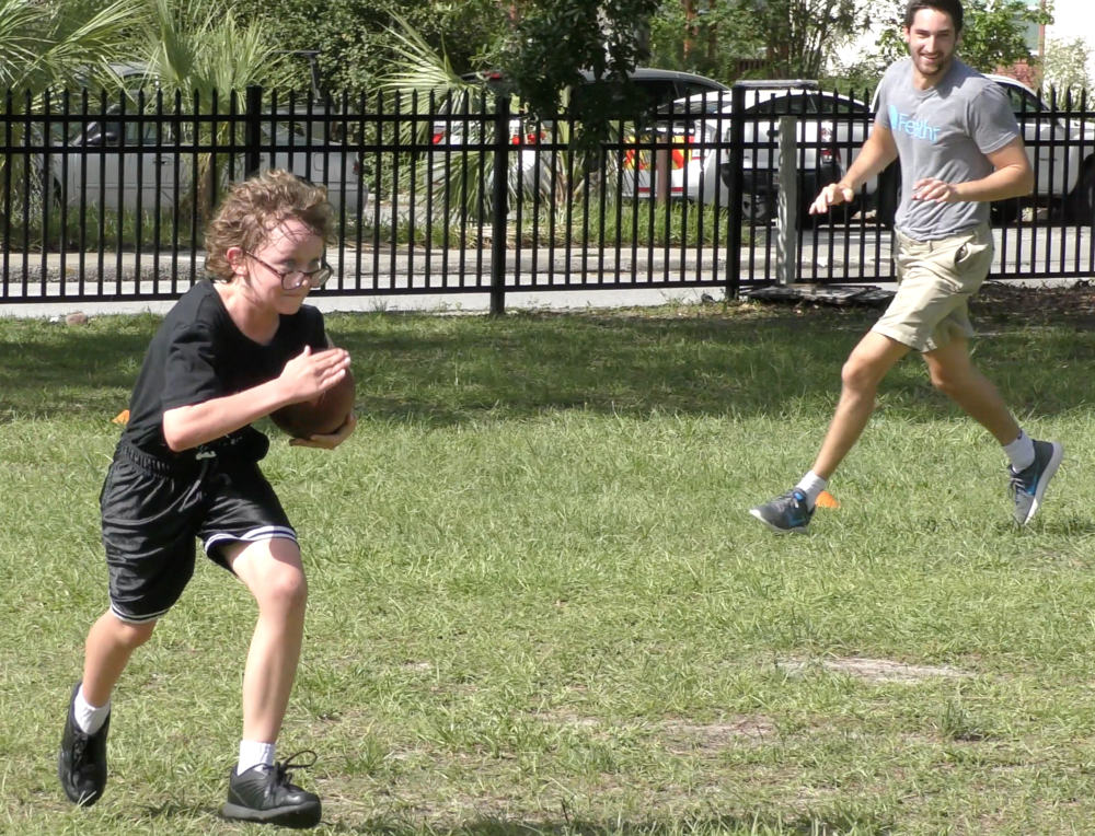 A Youth Combine student runs as he plays touch football.