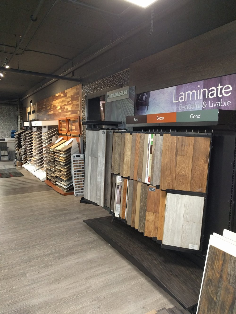 LAMINATE    Touchtone specializes in designer Laminate which is 12 mm and higher. We have over 100,000 square feet of laminate in stock and are able to special order anything you enjoy.