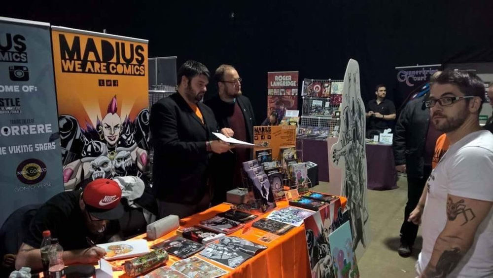 Above: The Madius crew at last year's Thought Bubble looking like doormen checking the names list for access to the Raëlian mothership. (image from @MadiusComics)