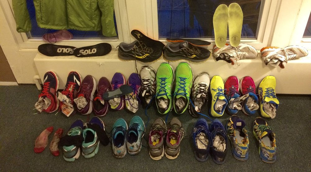 Display of wet shoes at running camp a few years ago - note the newspaper stuffed inside and removed insoles. We also had fans blowing on them from either side.
