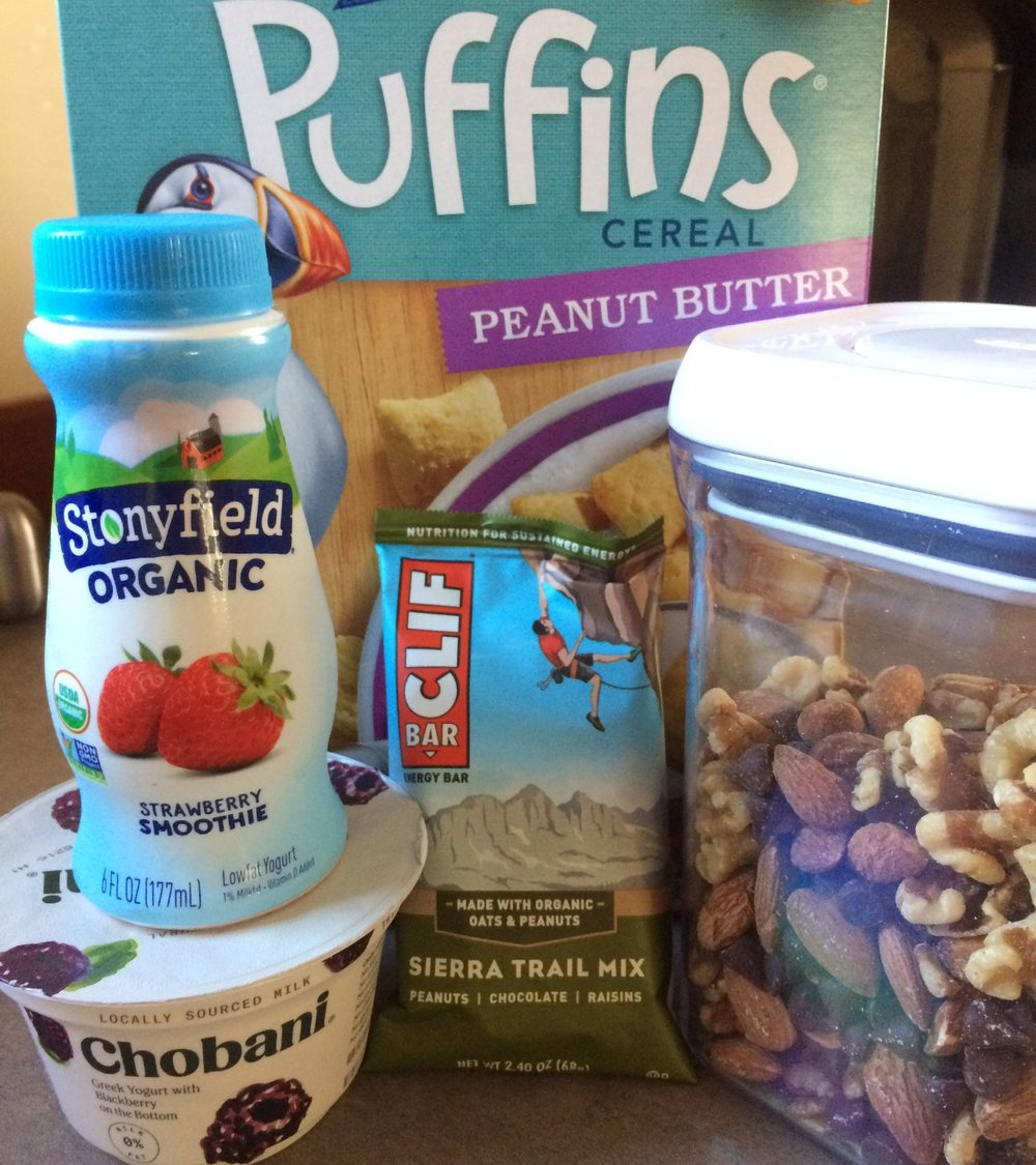 Barbara's peanut butter puffins cereal, Stonyfield strawberry smoothies, Chobani yogurts (especially blackberry and key lime pie), Clif bars (especially Sierra Trail Mix and Chocolate Brownie), and homemade trail mix (almonds and walnuts with mini chocolate chips)