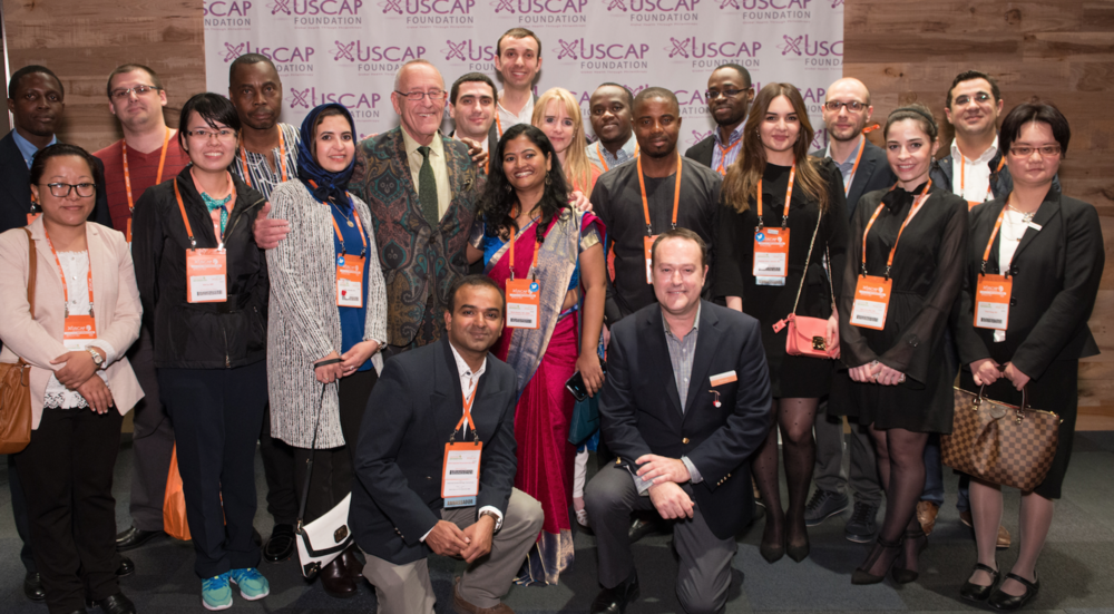 Executive Vice President David B. Kaminsky shares a moment with some of the USCAP Foundation Global Partner Travel Award Winners.