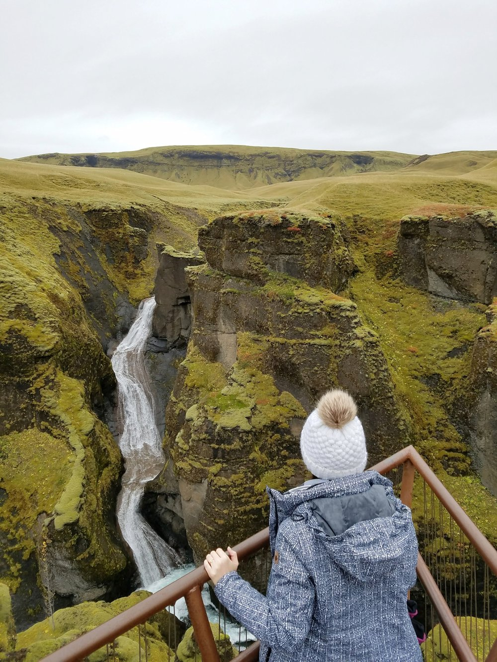 Some of the best Iceland waterfalls are in the south region of Iceland. Fjadrargljugur runs through a mossy green canyon. dsfoss but hidden by cliffs. #travel #iceland #icelandtravel #wanderlust #europe #waterfalls #naturepics  #icelandwaterfalls #waterfallsaroundtheworld #traveldestinations #traveltips