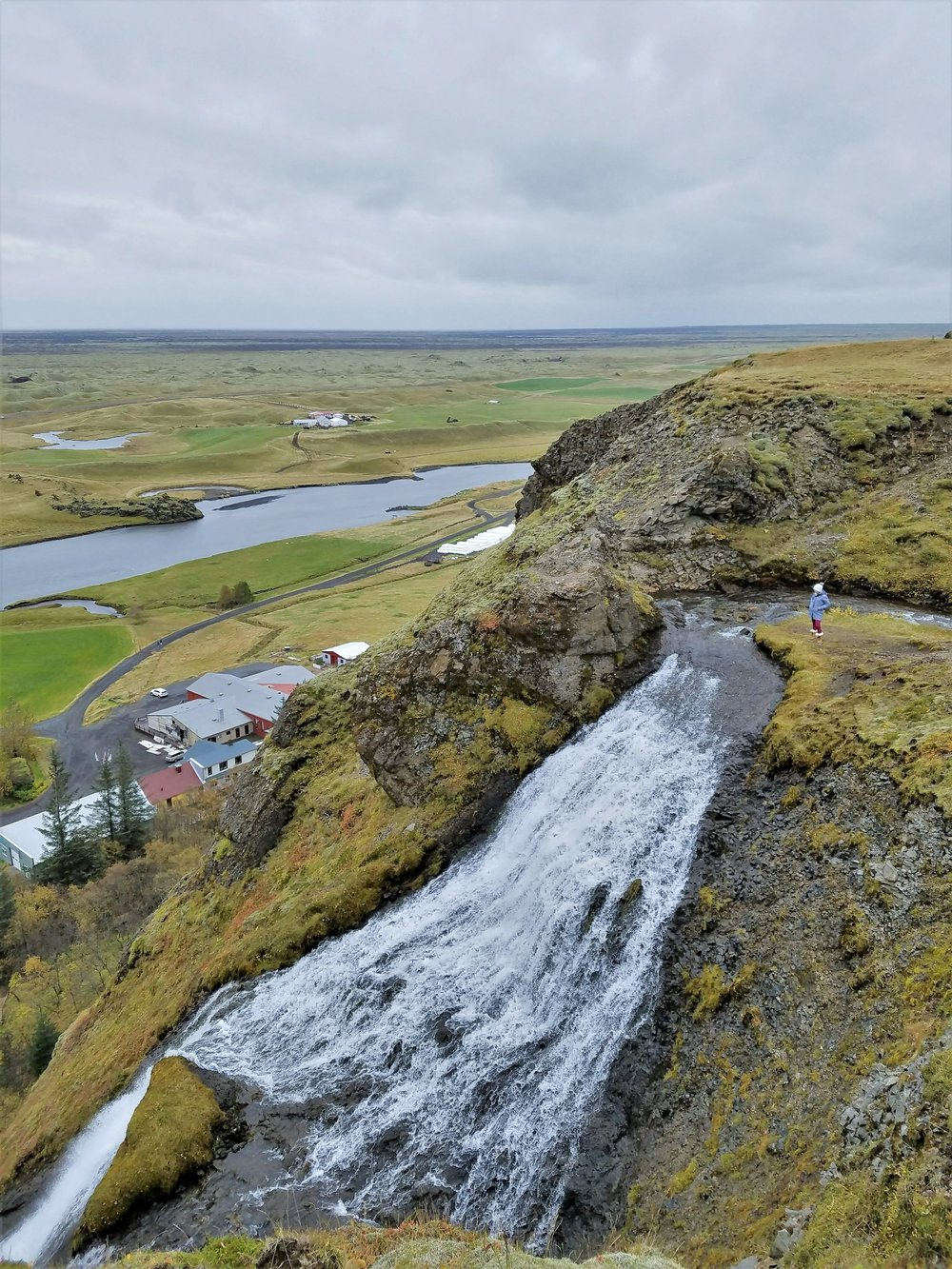 Systrafoss along the south coast of Iceland is a quiet, uncrowded waterfall. You can climb to the top for views all the way to the ocean. #travel #iceland #icelandtravel #waterfalls #icelandwaterfalls #traveldestinations #waterfallsaroundtheworld #icelandsights #europetravel