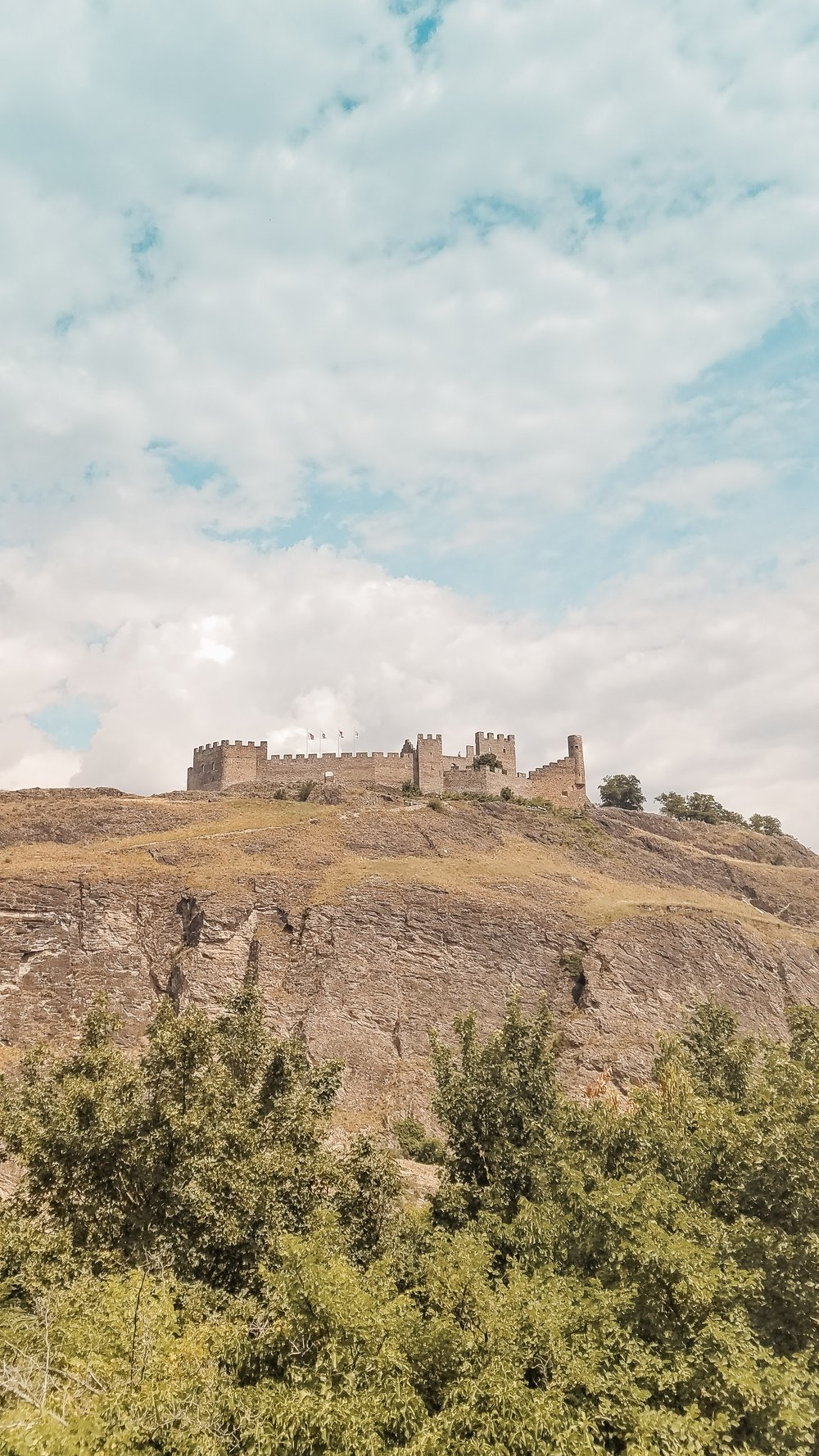 Tourbillon Castle in Sion can be seen from its neighboring chateau. You have to climb stairs uphill to reach either one, but the views are worth it. #Travel #Switzerland #Castle #Travelblogging #Lifestyle #TravelTip #swisscastle