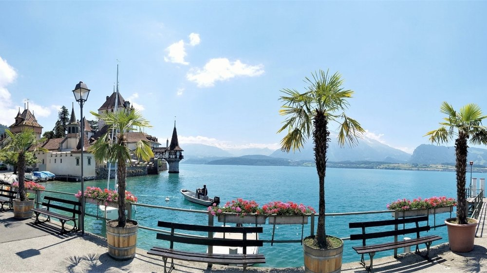 Schloss Oberhofen on Thunersee in Switzerland is surrounded by a lake, mountains and beautiful gardens. #Travel #Switzerland #Europe