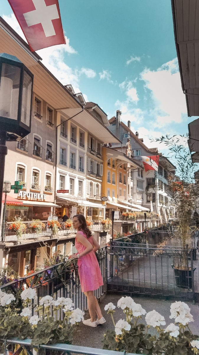 The town of Thun, Switzerland, is on the the shores of Thunersee. The old town district has a castle, historic church, and tons of colorful buildings. #Switzerland #Thun #Europe #Travel #Lifestyleblog