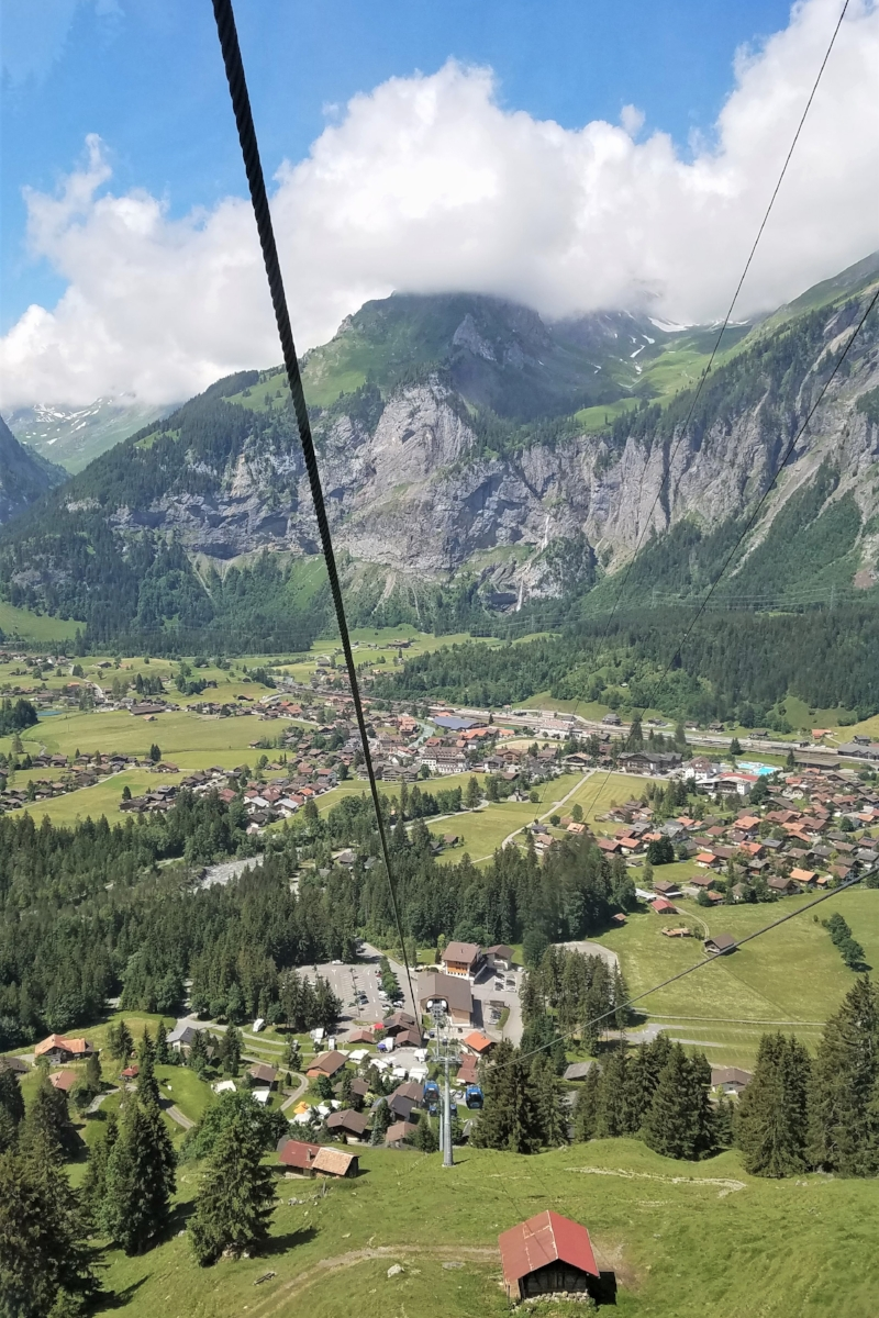 To get to Lake Oeschinen, you can either hike up the mountain or take a cable car. Both options provide incredible views of the town of Kandersteg down below. #Switzerland #Travel #Traveltips #Wheretogo #mountains