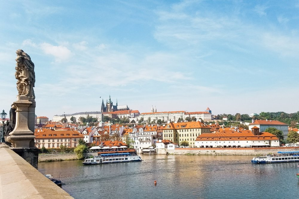 The Charles Bridge crosses the Vltava River in Prague, one of the grand capital cities covered in this one-week Central Europe itinerary to Vienna, Prague and Budapest.
