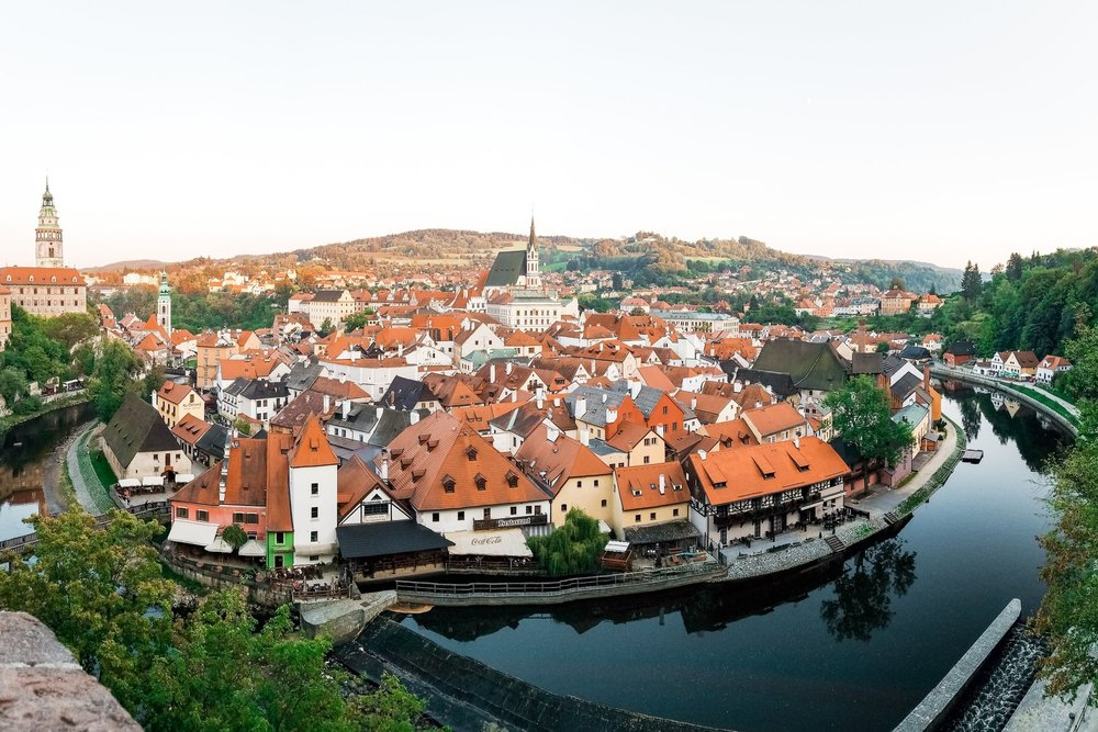 One of the best things to do in Cesky Krumlov is to visit the Cesky Krumlov Castle hilltop for this iconic view looking over the Vltava River and downtown.