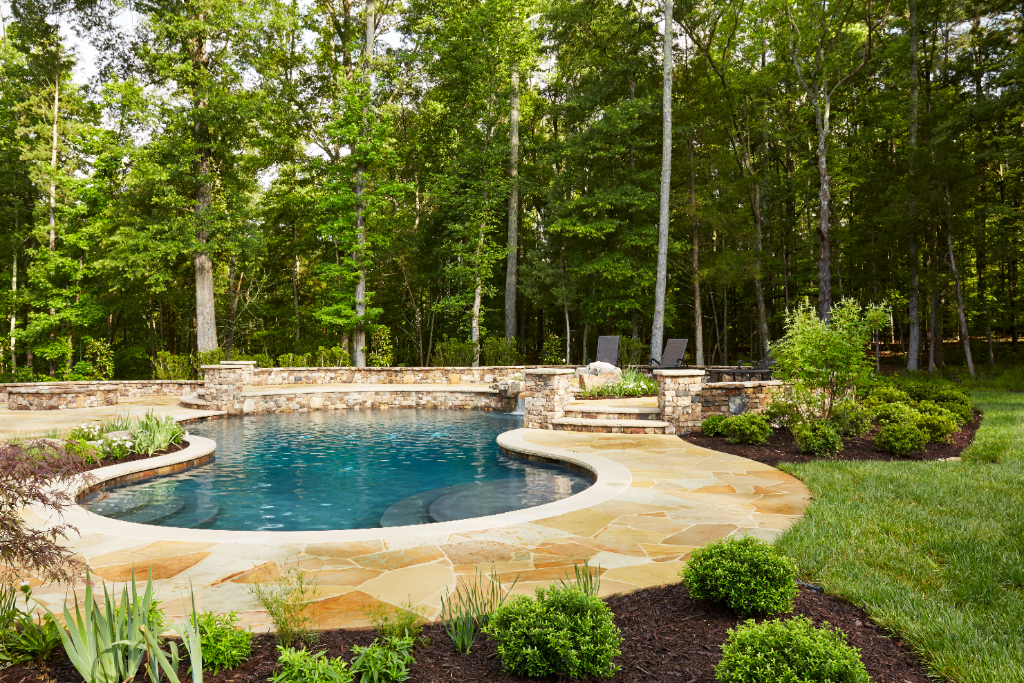 pool with outdoor kitchen backyard freeform boulder pool on country estate with contemporary feel builders choice award tudor home outdoor living area with multiple stone waterfall kitchen marcia fryer