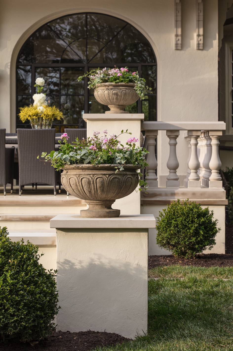 Marcia Fryer Landscape Designs | Baskerville Designed Mediterranean Inspired Home | AFTER Steel WIndows and Urns.png