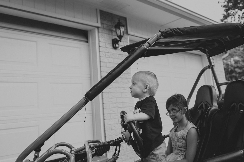 documentary lifestyle family photo sessions little boy at steering wheel Ore Adesina Photography Oklahoma City