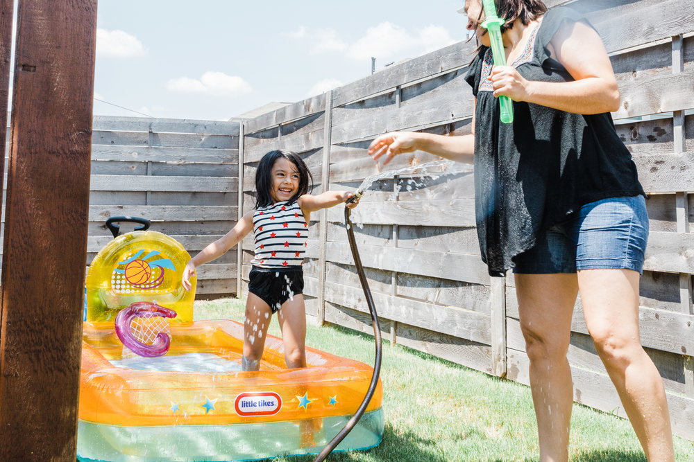 documentary lifestyle family photo session summer backyard mom and daughter in pool Ore Adesina Photography Oklahoma City