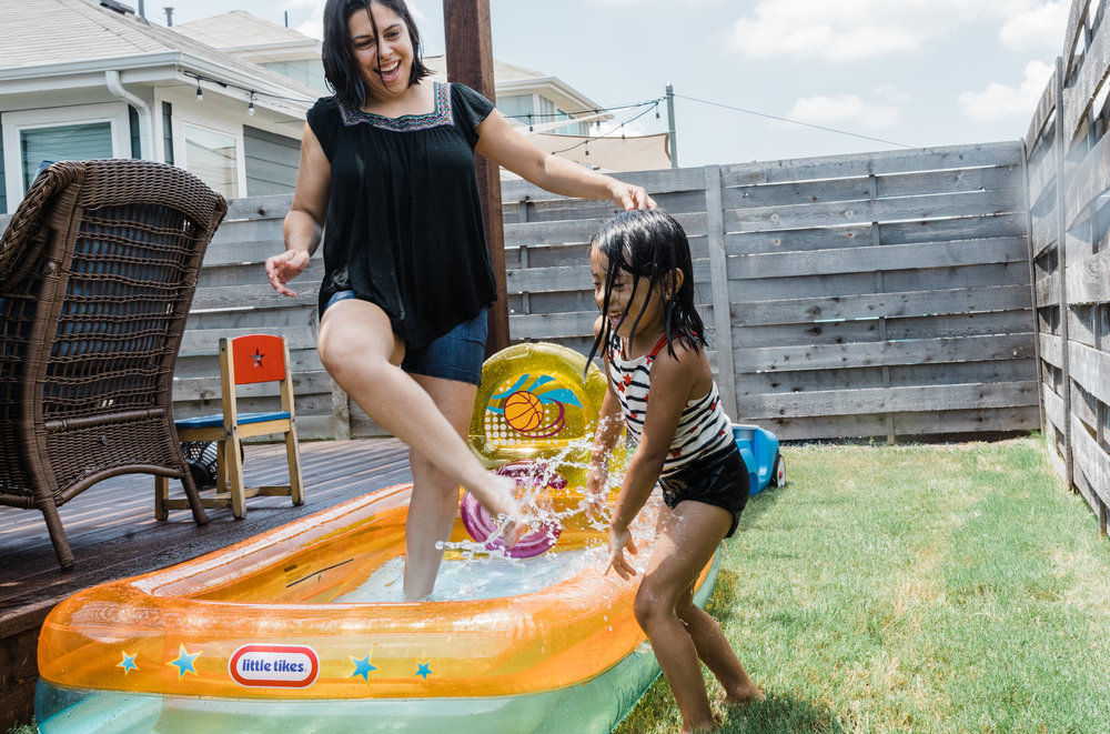 family documentary lifestyle photo session mom and girl in pool backyard summer Ore Adesina Photography Oklahoma City