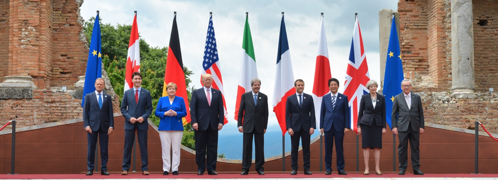 President Trump and Prime Minister May with other world leaders at the 2017 G7 Summit in Sicily ( source )