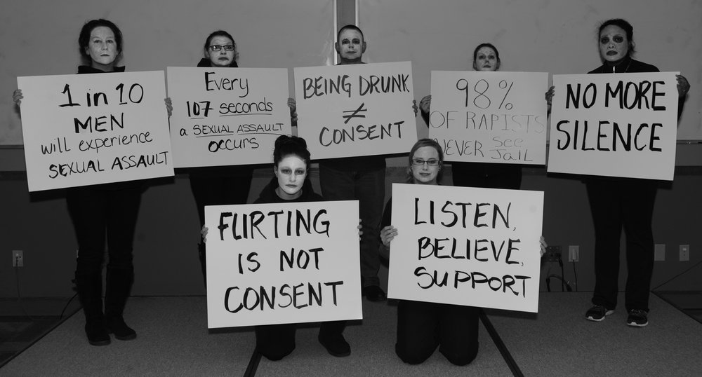 """Participants in a """"living display"""" at an event at Ellsworth Air Force Base during Sexual Assault Awareness and Prevention Month in 2016 ( source )"""
