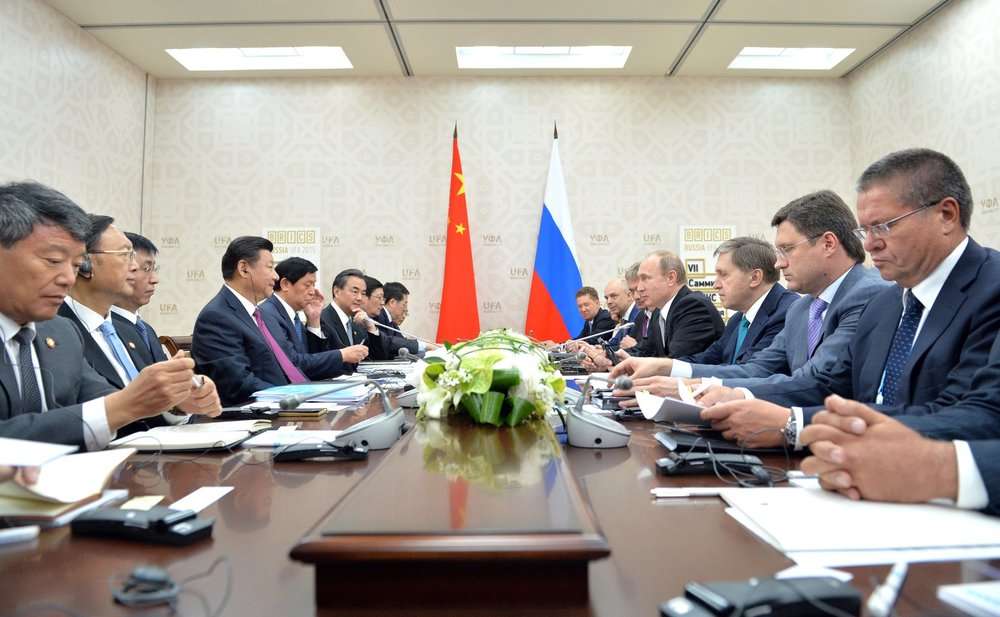 Presidents Jinping and Putin speaking at the BRICS Summit in 2015 ( source )