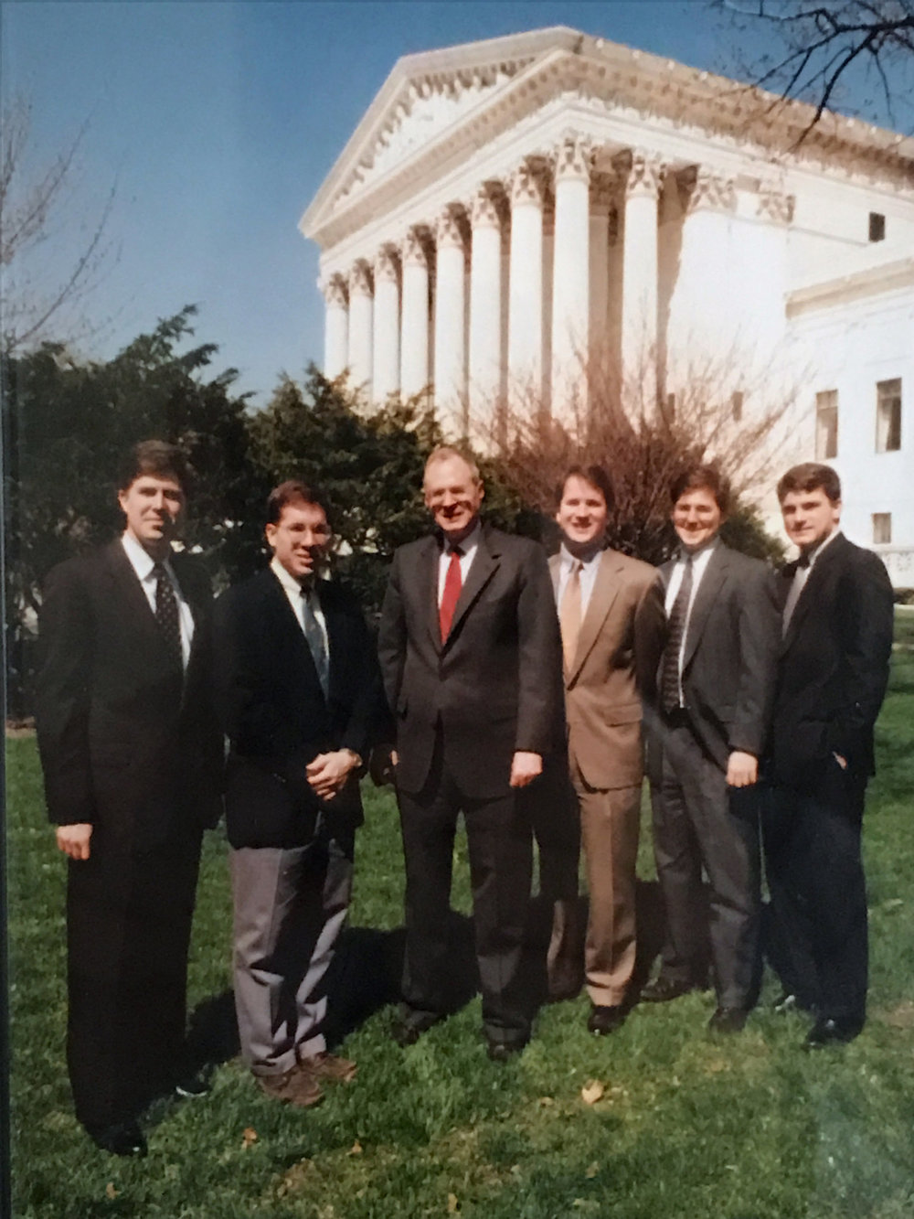 Kavanaugh, Gorsuch, and fellow clerks with Justice Anthony Kennedy in 1993 ( source )