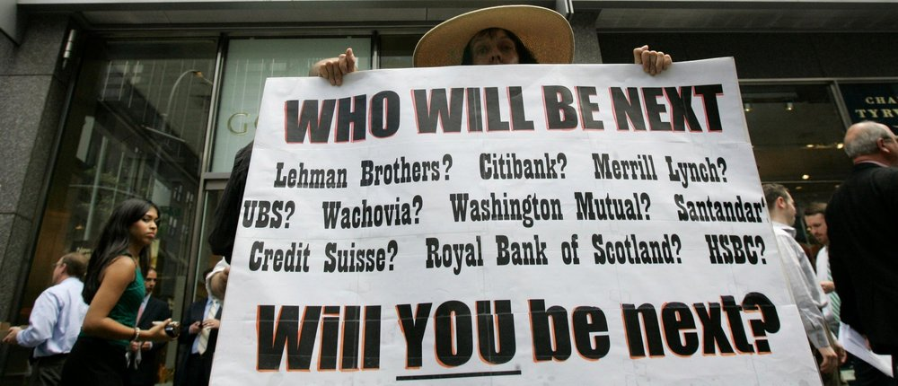 A demonstrator holds a sign outside of Lehman Brothers' headquarters in New York in 2008 ( Image )
