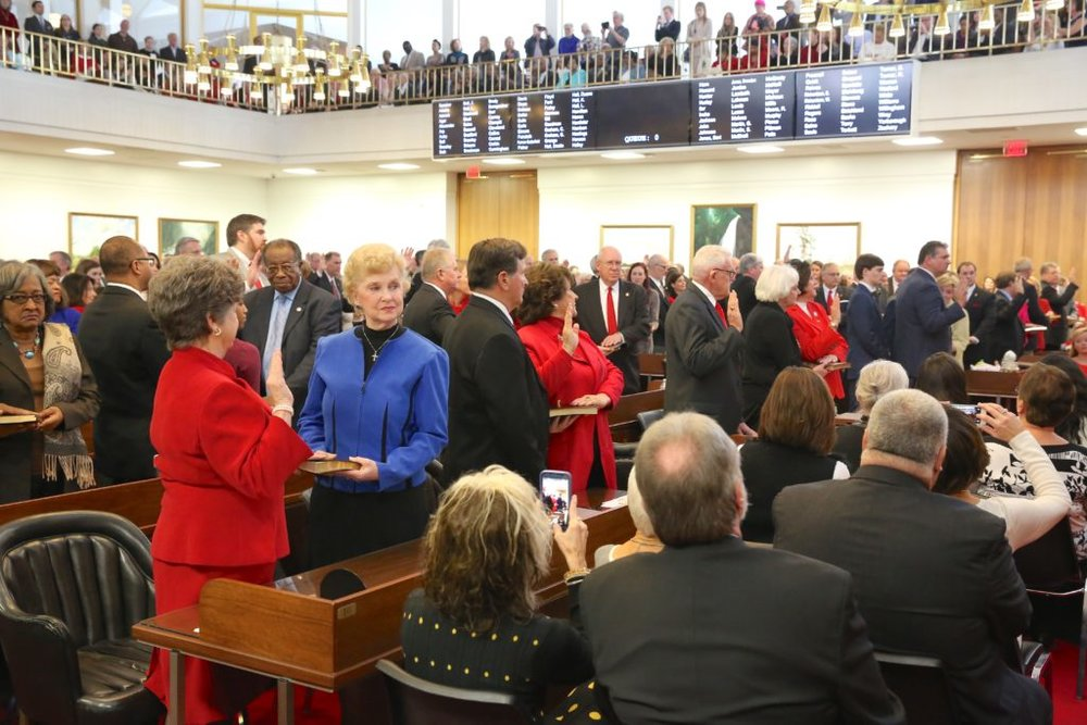 State Representatives taking the oath of office in January before the 2017 legislative session ( Image )