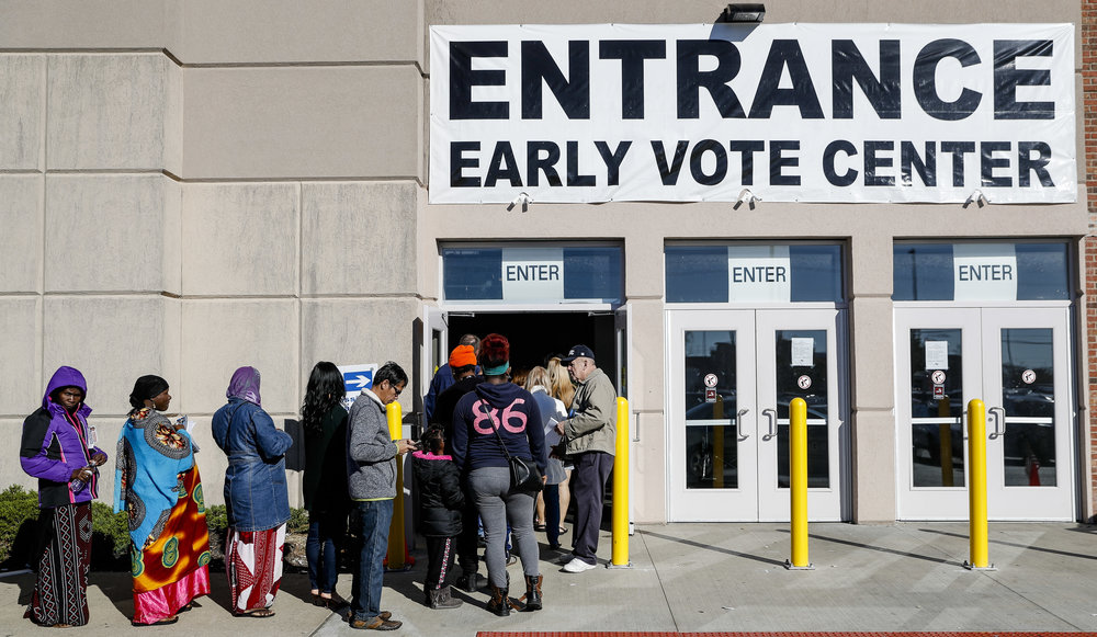Voters line up outside an early voting polling place in Columbus, Ohio ( Image )