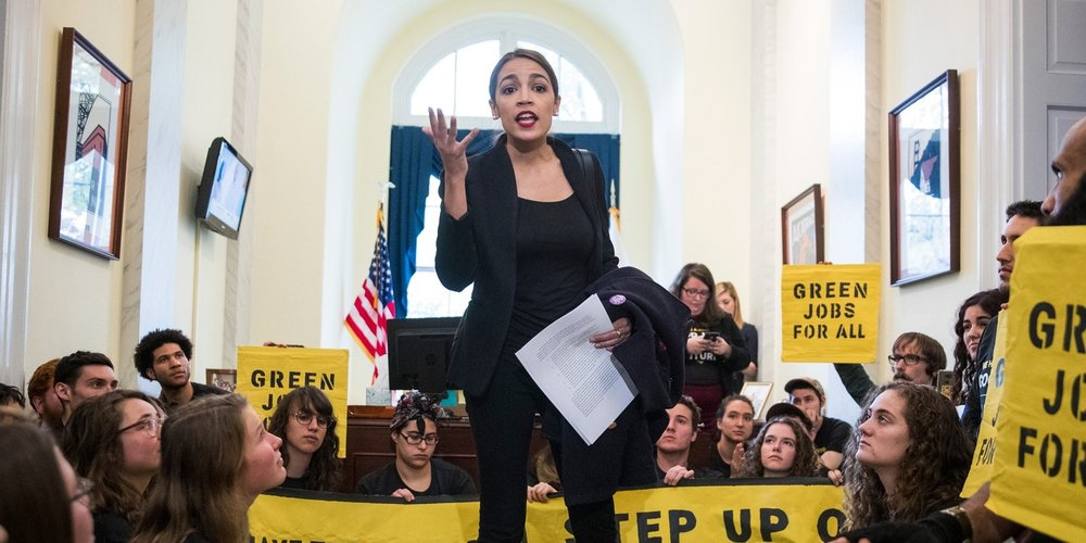 Incoming Representative Alexandria Ocasio-Cortez speaking to a group of activists from the Sunrise Movement in the Capitol ( Image )