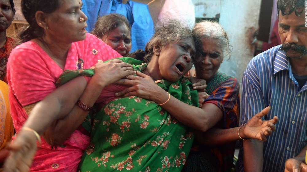 A woman grieves after scores of Indians died after consuming toxic alcohol in a Mumbai slum ( Image )