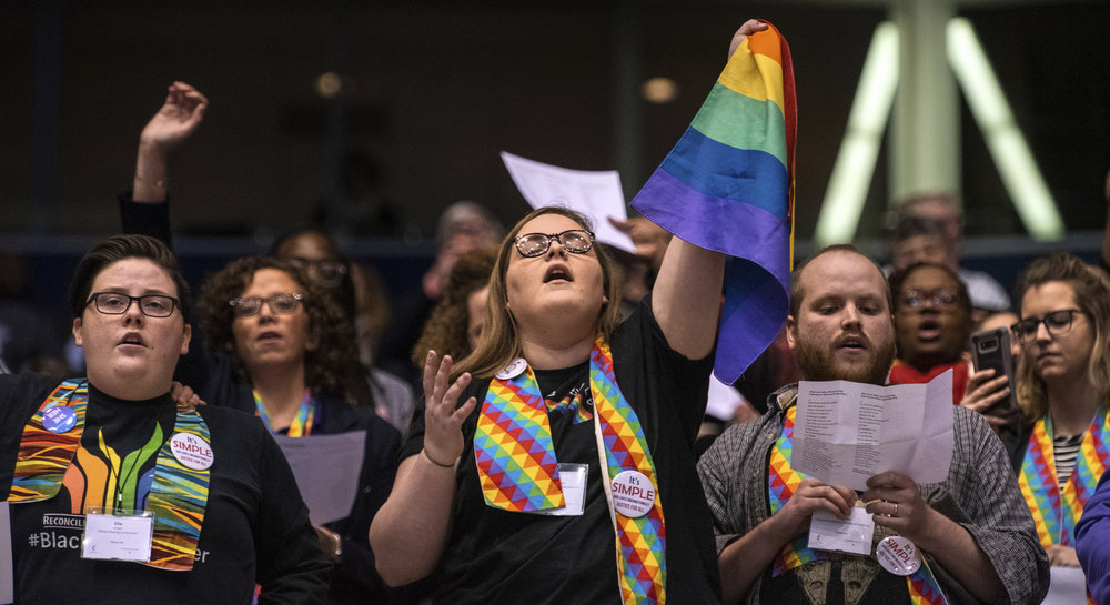 LGBTQ+ rights advocates attend the United Methodist Church's General Conference in St. Louis last month ( Image )